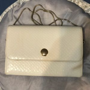 White lined dress purse with gold chain